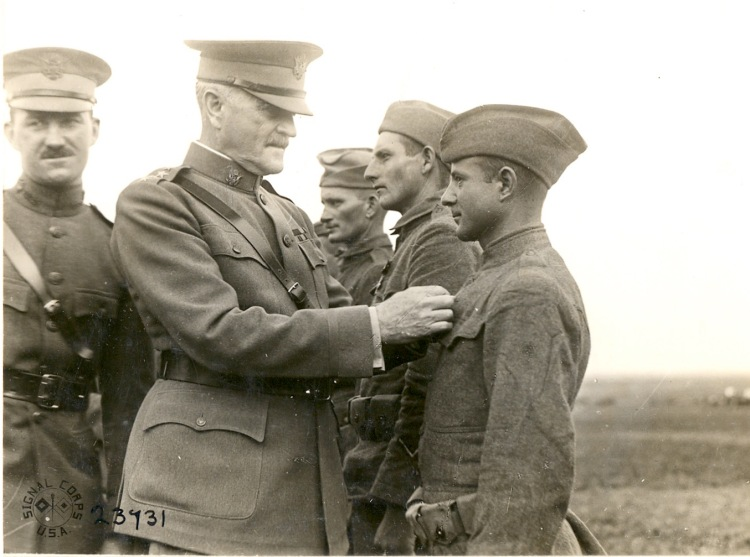 Pershing pins medal on US soldier