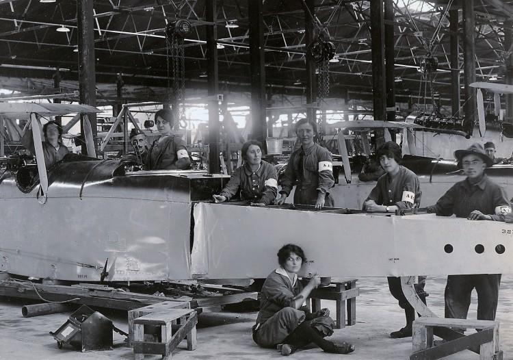 Women building plane