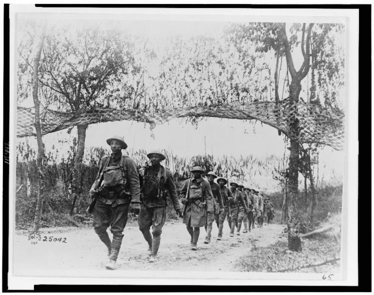 WWI U.S. Army Infantry troops, African American unit, marching northwest of Verdun, France, in World War I