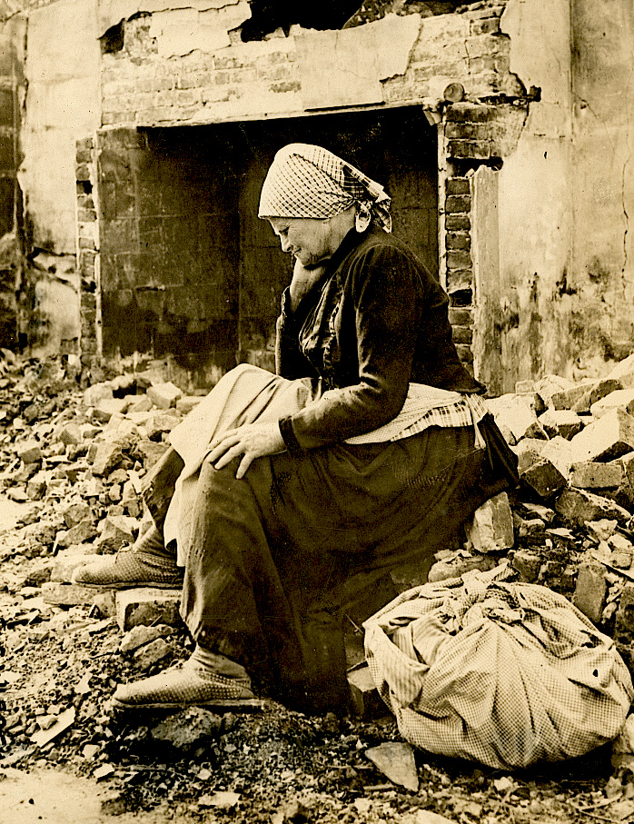 WWILearning of German retreat from her district French woman returns to find her home a heap of ruins